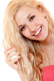 Young cheerful woman doing hair styling Stock Image