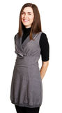 Young cheerful woman in gray dress Royalty Free Stock Photo