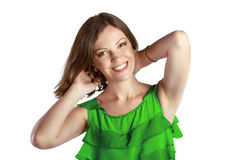 Young cheerful woman in green dress winth her hands at the head Stock Photos