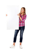 Young cheerful woman holding empty banner Royalty Free Stock Photos