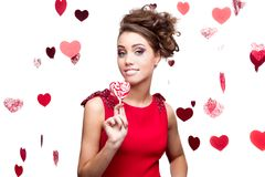 Young cheerful woman holding lollipop Stock Image