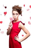 Young cheerful woman holding lollipop Stock Photos