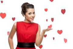 Young cheerful woman holding red paper heart Stock Images