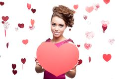 Young cheerful woman holding red paper heart Royalty Free Stock Photography