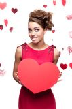 Young cheerful woman holding red paper heart Royalty Free Stock Images