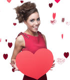 Young cheerful woman holding red paper heart Stock Image