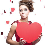 Young cheerful woman holding red paper heart Stock Photography