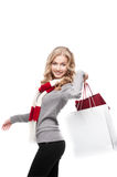 Young cheerful woman holding shopping bags Stock Image