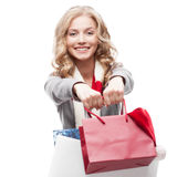 Young cheerful woman holding shopping bags Stock Photos