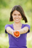 Young cheerful woman holding tomato Royalty Free Stock Photos
