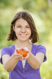 Young cheerful woman holding tomato Stock Photography