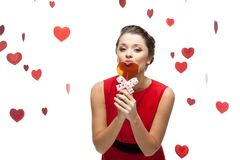 Young cheerful woman kissing lollipop Royalty Free Stock Photo