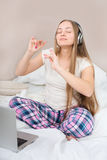 Young cheerful woman listening to music Stock Images