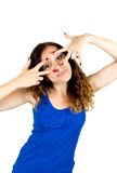 Young cheerful woman looking through fingers Stock Photo