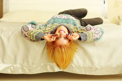 Young cheerful woman lying on the bed Royalty Free Stock Images