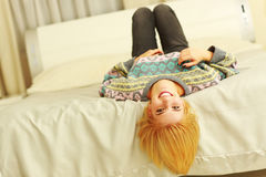 Young cheerful woman lying on the bed Royalty Free Stock Photo