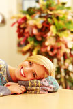 Young cheerful woman lying on the table Royalty Free Stock Photos
