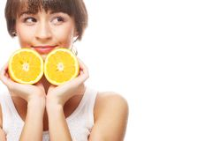 Young cheerful woman with oranges Royalty Free Stock Images