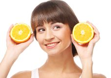 Young cheerful woman with oranges Stock Images