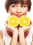 Young cheerful woman with oranges Stock Photo