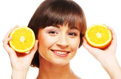 Young cheerful woman with oranges Stock Image