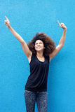 Young cheerful woman pointing finger up Stock Photo