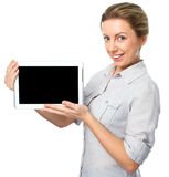 Young cheerful woman is showing blank tablet Royalty Free Stock Photo