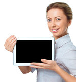 Young cheerful woman is showing blank tablet Stock Image
