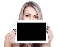 Young cheerful woman is showing blank tablet Stock Photos