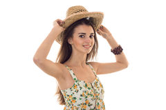 Young cheerful woman in straw hat and sarafan with floral pattern smiling on camera isolated on white background Stock Photography