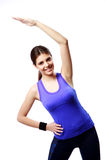 Young cheerful woman stretching Royalty Free Stock Images