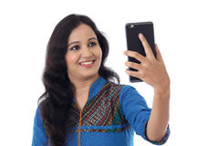 Young cheerful woman taking a selfie Stock Photo