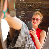 Young cheerful woman using smarthphone. Stock Image