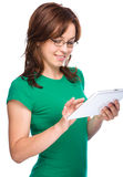 Young cheerful woman is using tablet Royalty Free Stock Photography