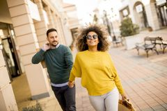 Young smiling couple shopping in an urban street royalty free stock images