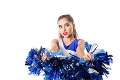 Young cheerleader in blue and white suit on white background stock image