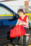 Young Cheerleader Goes Through Bag Stock Image