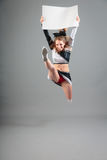 Young Cheerleader On Gray Background Royalty Free Stock Photo