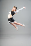 Young Cheerleader On Gray Background Stock Photos