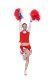 Young cheerleader holding pom-poms Royalty Free Stock Image