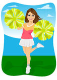 Young cheerleader holding pompoms Royalty Free Stock Photo
