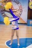 Young cheerleaders perform at the city cheerleading championship. Kamenskoye, Ukraine - March 8, 2017: Championship of the city of Kamenskoye in cheerleading Stock Images