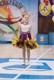 Young cheerleaders perform at the city cheerleading championship. Kamenskoye, Ukraine - March 8, 2017: Championship of the city of Kamenskoye in cheerleading Royalty Free Stock Photos