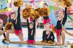 Young cheerleaders perform at the city cheerleading championship. Kamenskoye, Ukraine - March 9, 2017: Championship of the city of Kamenskoye in cheerleading Royalty Free Stock Image