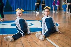 Young cheerleaders perform at the city cheerleading championship. Kamenskoye, Ukraine - March 8, 2017: Championship of the city of Kamenskoye in cheerleading Royalty Free Stock Photos