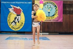 Young cheerleaders perform at the city cheerleading championship. Kamenskoye, Ukraine - March 8, 2017: Championship of the city of Kamenskoye in cheerleading Royalty Free Stock Image
