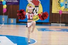 Young cheerleaders perform at the city cheerleading championship. Kamenskoye, Ukraine - March 8, 2017: Championship of the city of Kamenskoye in cheerleading Stock Photo