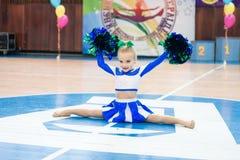 Young cheerleaders perform at the city cheerleading championship. Kamenskoye, Ukraine - March 8, 2017: Championship of the city of Kamenskoye in cheerleading Stock Photography