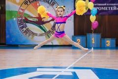 Young cheerleaders perform at the city cheerleading championship. Kamenskoye, Ukraine - March 8, 2017: Championship of the city of Kamenskoye in cheerleading Stock Image