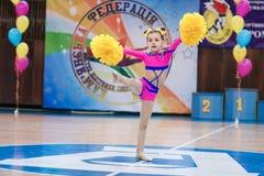 Young cheerleaders perform at the city cheerleading championship. Kamenskoye, Ukraine - March 8, 2017: Championship of the city of Kamenskoye in cheerleading Royalty Free Stock Photo